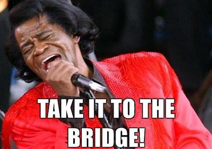 James Brown singing into his microphone.